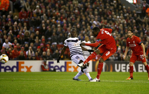 Benteke's brilliance sees Liverpool into Europa last-32