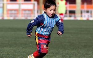 Afghan boy (five) in homemade Messi shirt could meet hero