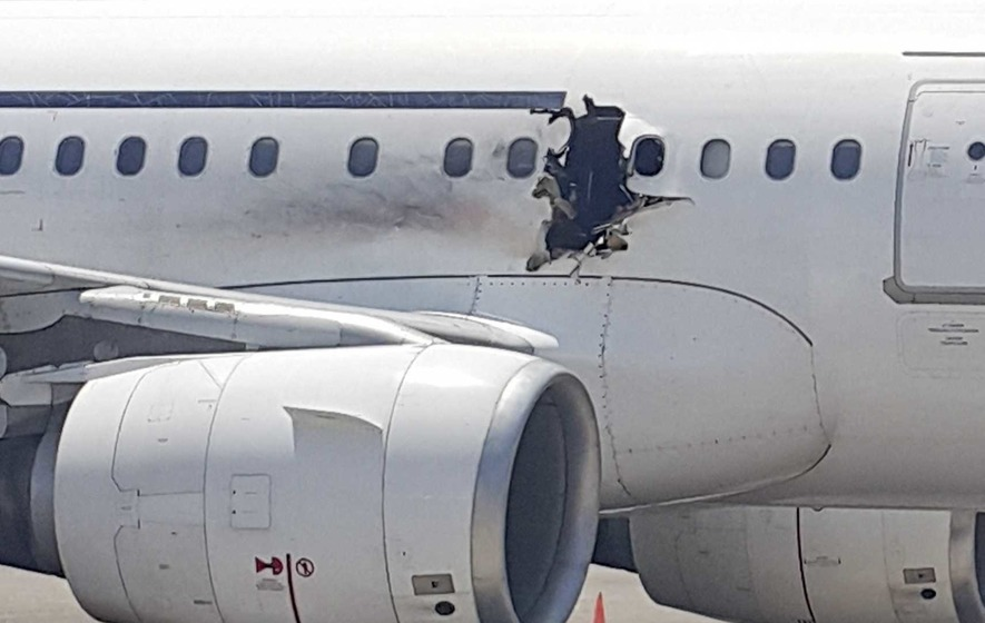 Explosion blows hole in side of passenger plane