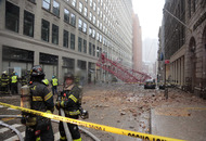 One killed as crane collapses on parked cars in New York street