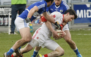 Tyrone hold off late Laois surge to maintain unbeaten record