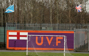 Belfast IFA league sees children play soccer beside UVF mural
