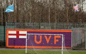 Belfast IFA league sees children play soccer beside UVF mural