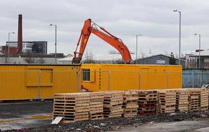 Loyalists stack bonfire pallets on building site for nursery school