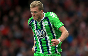 Wolfsburg make Champions League quarters for first time