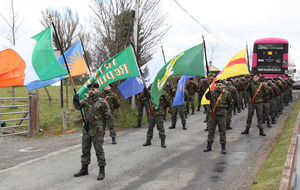 Men and women in combat gear take part in Tyrone Rising commemoration
