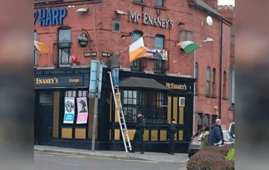 Policeman 'helps' republican erect tricolour in Belfast
