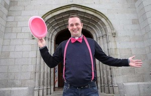 Priest dances his way through Newry for charity GAA event