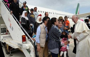 Pope Francis brings 12 Syrian Muslims to Italy on his plane