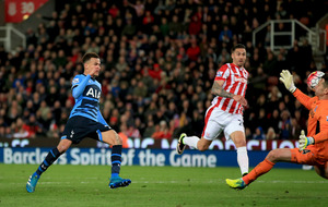 Tottenham cut Leicester's lead at top to five with win at Stoke
