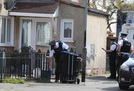 West Belfast shooting: Police hunt for men after murder bid