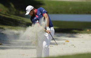 Jason Day overcomes 'nasty' conditions to maintain lead