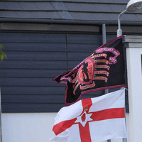 Loyalist flags still fly at new housing development one year on
