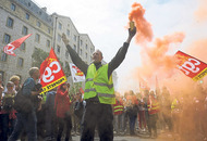 French workers throw smoke bombs as protests over labour bill escalate