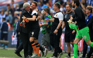 Hull City beat Sheffield Wednesday to seal Premier League spot