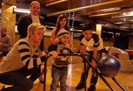 Children with cancer enjoy surprise bowling alley visit from One Direction's Niall Horan