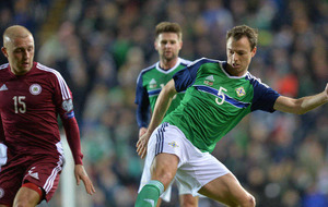 Northern Ireland's Jonny Evans keen to take on star strikers