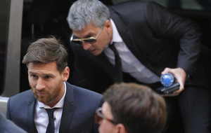 Barcelona's Lionel Messi appears in court with his father to answer tax fraud charges