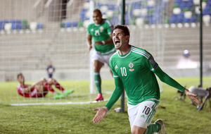 Kyle Lafferty limps out of Northern Ireland training in France