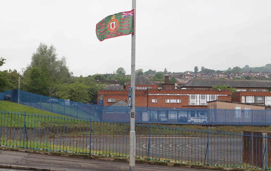 Loyalist group's new flag flown outside Belfast Catholic school