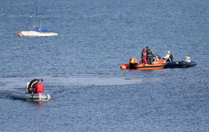 Missing divers found 'safe and well' after sea search
