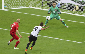 Germany draw with Poland to leave group finely balanced