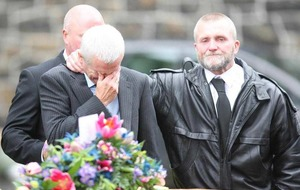 Mourners wear football shirts at funeral of Northern Ireland fan Darren Rodgers