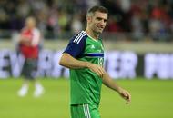 Veteran Northern Ireland defender Aaron Hughes will not rush retirement decision