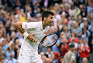 Novak Djokovic eases into third round at rain-hit Wimbledon