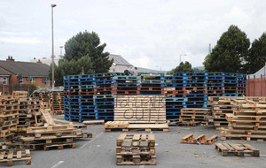 Loyalists meet bonfire builders after racist slogan appears in east Belfast