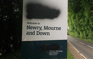 Police probe vandals who defaced Irish language signs
