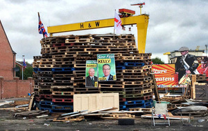 Loyalist bonfires block roads and burn election posters