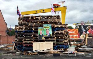 Loyalist bonfires block roads and burn election posters
