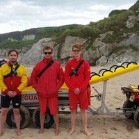 RNLI lifeguards rescue body boarders in heavy swell at Whiterocks beach