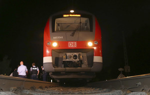 Islamic State claim responsibility for 17-year-old's axe attack on German train
