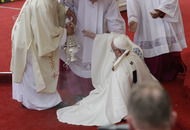 Pope Francis falls at Mass in Poland after missing step