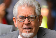 Rolf Harris in court accused of indecently assaulting young girls
