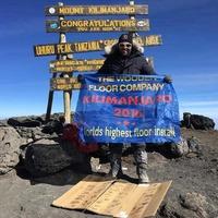 Businessman 'lays wooden floor at top of Mount Kilimanjaro'