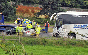 Call for safety review of road following fatal crash between coach and car