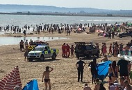 Three men die after being pulled from sea on hottest day