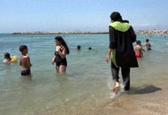 France's top administrative court overturns burkini ban