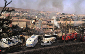 Kurdish suicide bomber kills at least 11 police officers at checkpoint