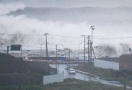 Typhoon brings flood threat to northern Japan