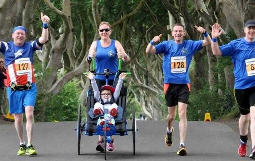 Seven-year-old with terminal condition takes part in Derry half marathon