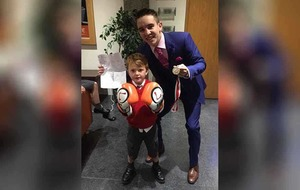 Michael Conlon presents young boxing fan with gloves gift