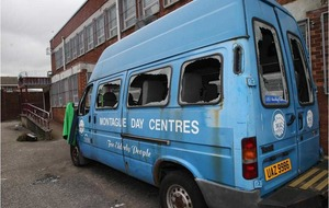 Windows smashed on vehicles used by west Belfast charity
