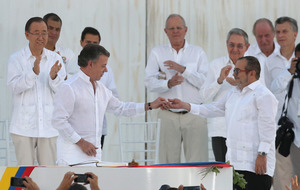 Colombian rebels sign historic peace accord with government