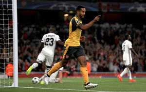 Theo Walcott doubles up as Arsenal cruise to win over Basle