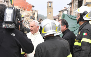 Pope Francis prays alone in rubble at scene of Italian earthquake