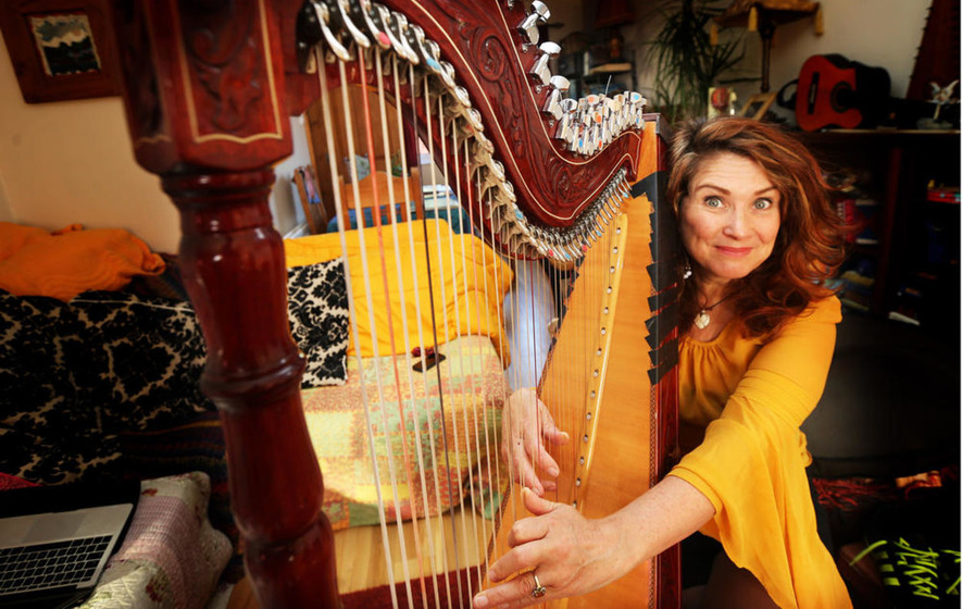 Belfast musician left out of work by damage to her harp